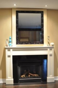 Make a statement with a beautiful framed mirror over your mantle.